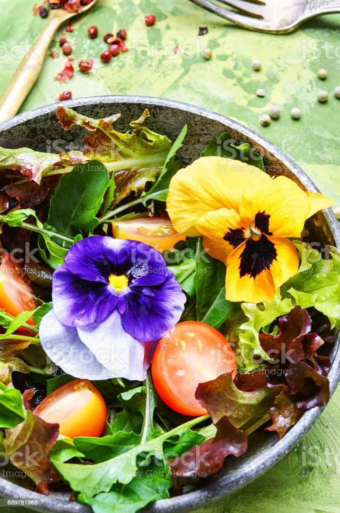 Spring salad with herb and flower stock photo