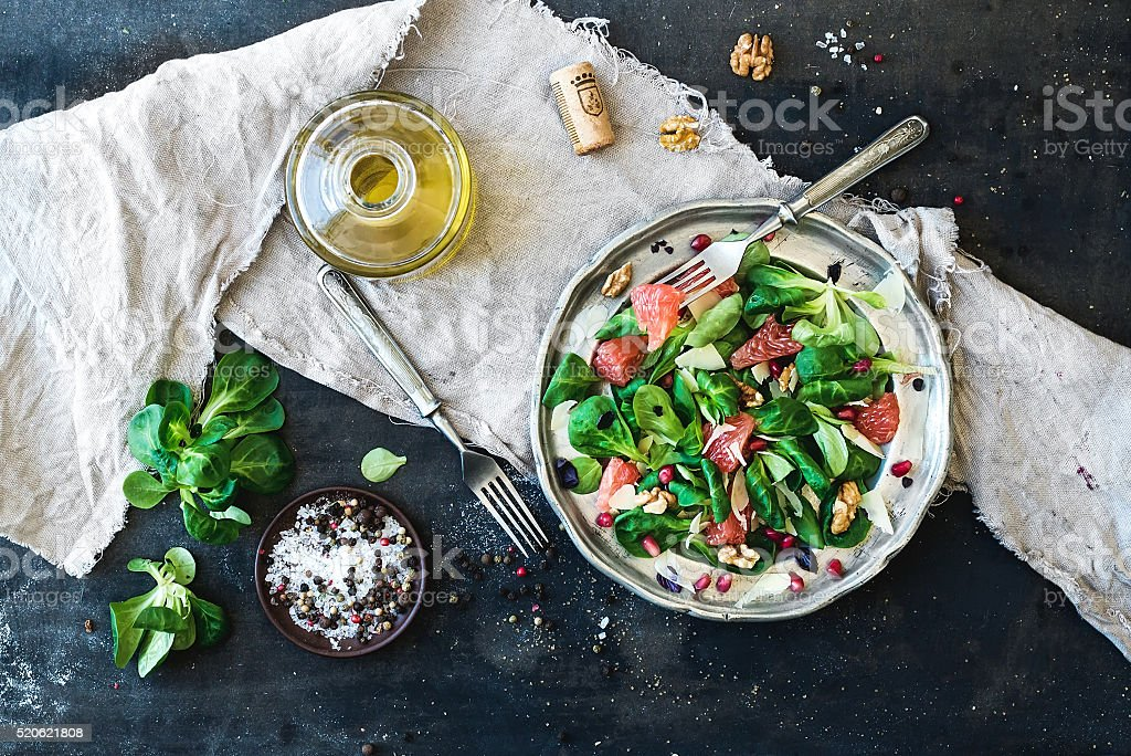 Spring salad with lamb's lettuce, grapefruit, garnet, walnuts and stock photo