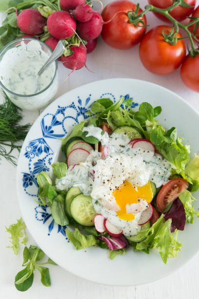 Spring salad with poached egg stock photo