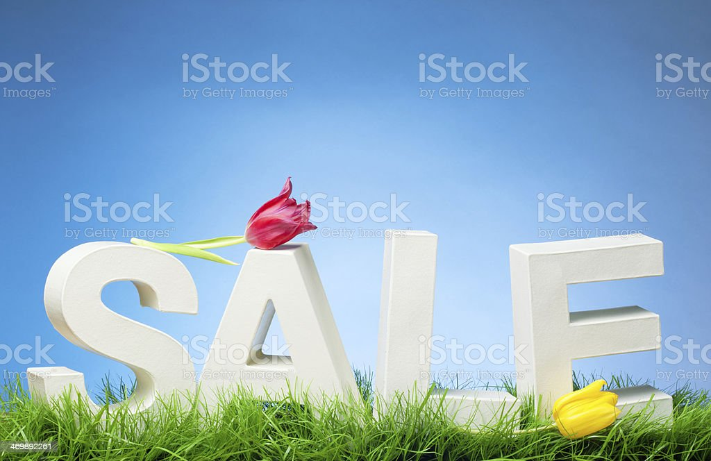 Spring Sale - Word on Grass with Tulips stock photo