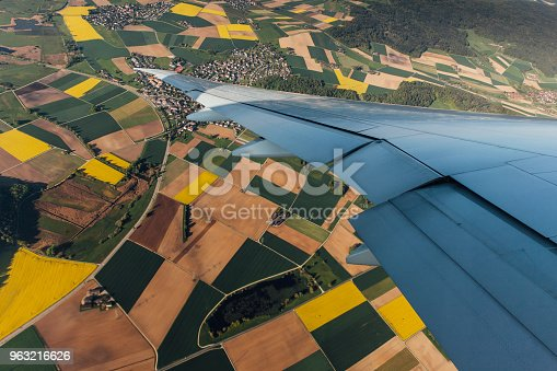 900763322 istock photo Spring scenery from the air through the airplane window 963216626