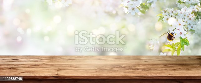 istock Spring scenery with wooden table 1125638748
