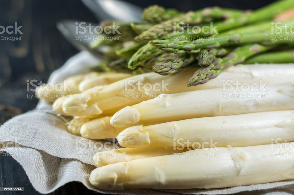 Spring season - fresh white and green uncooked asparagus stock photo