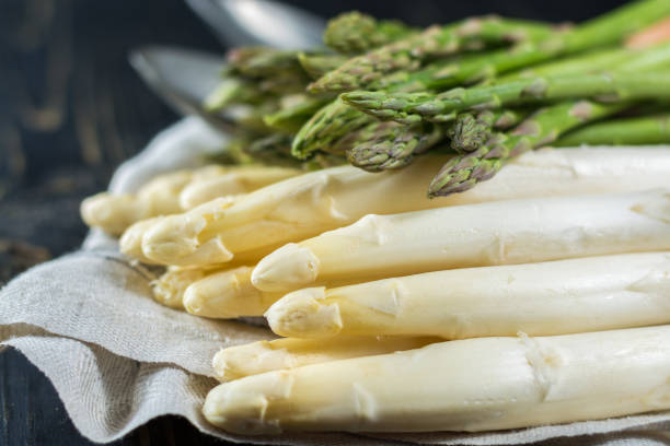 spring season - fresh white and green uncooked asparagus - asparagus stock pictures, royalty-free photos & images