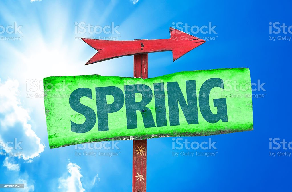 Spring sign with sky background stock photo