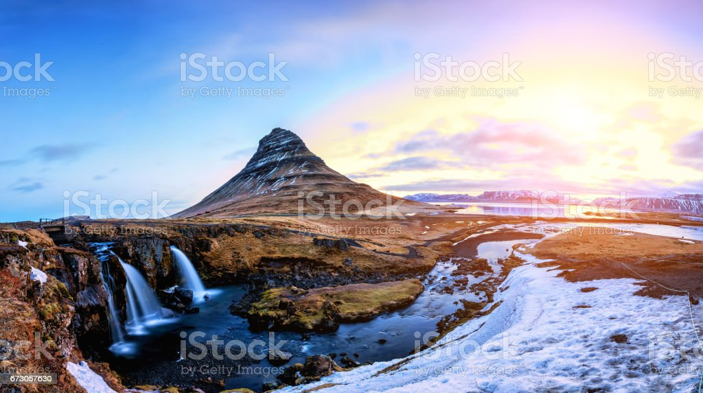 Spring sunrise over the famous Kirkjufellsfoss Waterfall with Kirkjufell mountain stock photo