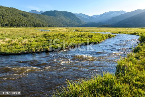 istock Spring Sunset at Big Thompson River - Evening sun shines on rushing Big Thompson River at Moraine Park in Rocky Mountain National Park, Colorado, USA. 1192910803