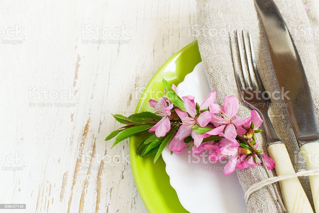 Spring table setting closeup, Decorated branch of flowering almo stock photo