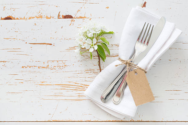 Spring table setting with white flowers stock photo