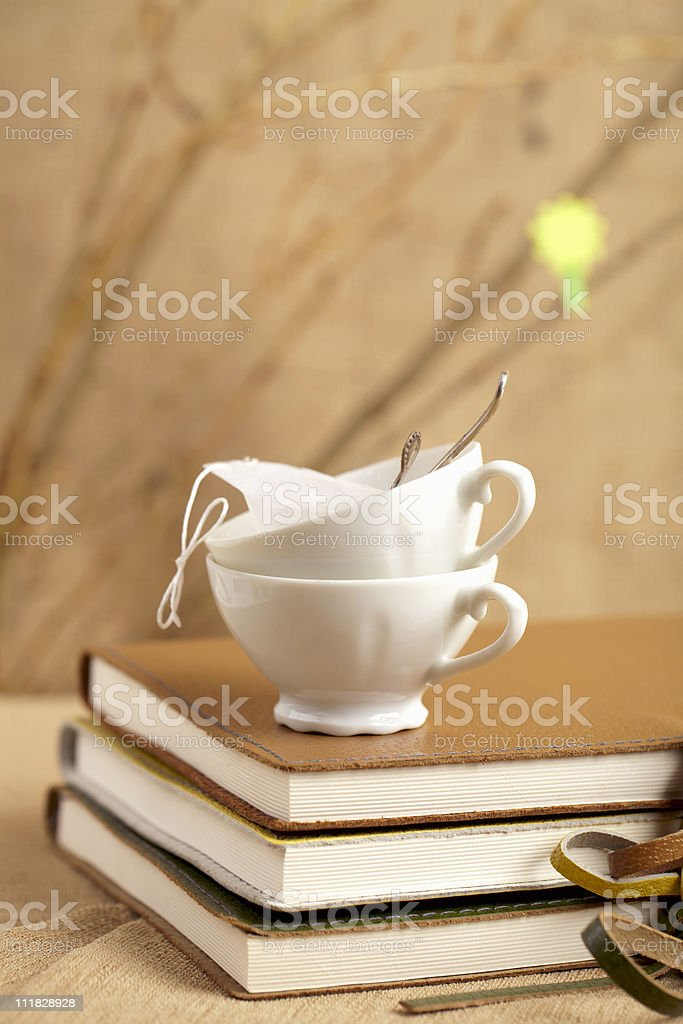 spring tea breake cups with diaries and twigs royalty-free stock photo