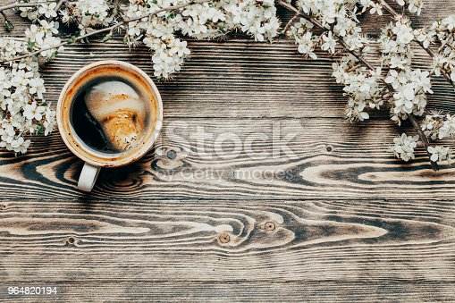 istock Spring top view wooden background with coffee and blossoming tre 964820194