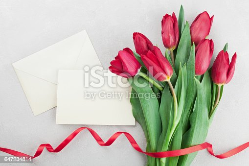 istock Spring tulip flowers and paper card for Mothers Day. 647234814