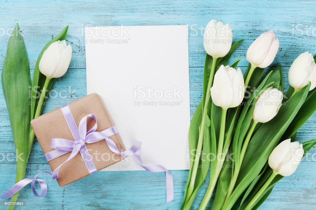 Spring tulip flowers, gift box and paper card. Flat lay. stock photo