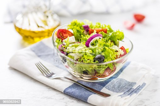 879977192 istock photo Spring vegetable salad with tomatoes onion cheese and olives 969363942