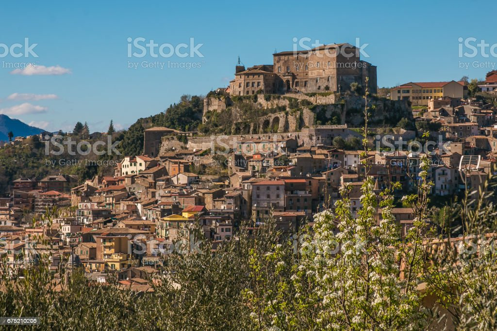 Spring view of Subiaco medieval village with blooming cherry tree royalty-free stock photo
