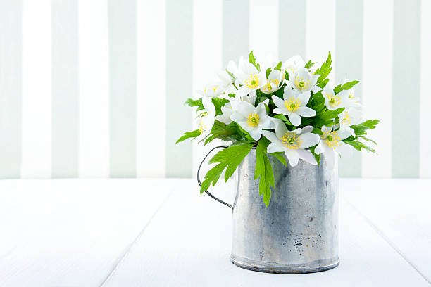 Spring wild flowers in an old metal cup stock photo