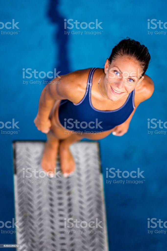 Springboard diving champion, looking at the camera stock photo