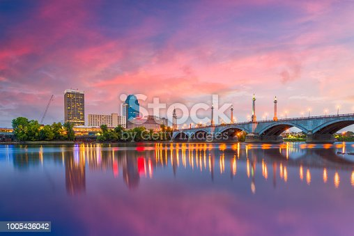 Springfield, Massachusetts, USA downtown skyline on the river at dusk.