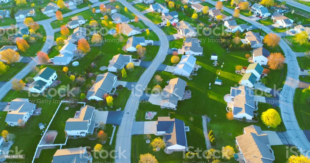 Springtime, beautiful neighborhoods, nice homes, aerial view at sunrise. stock photo