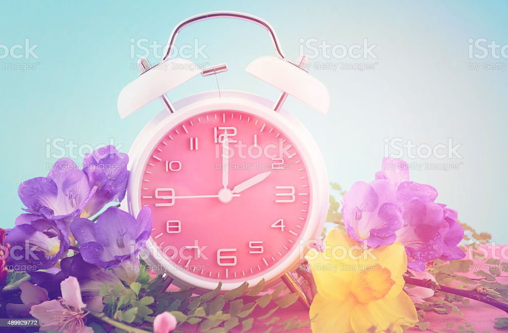 Springtime Daylight Saving Time Clock Concept stock photo