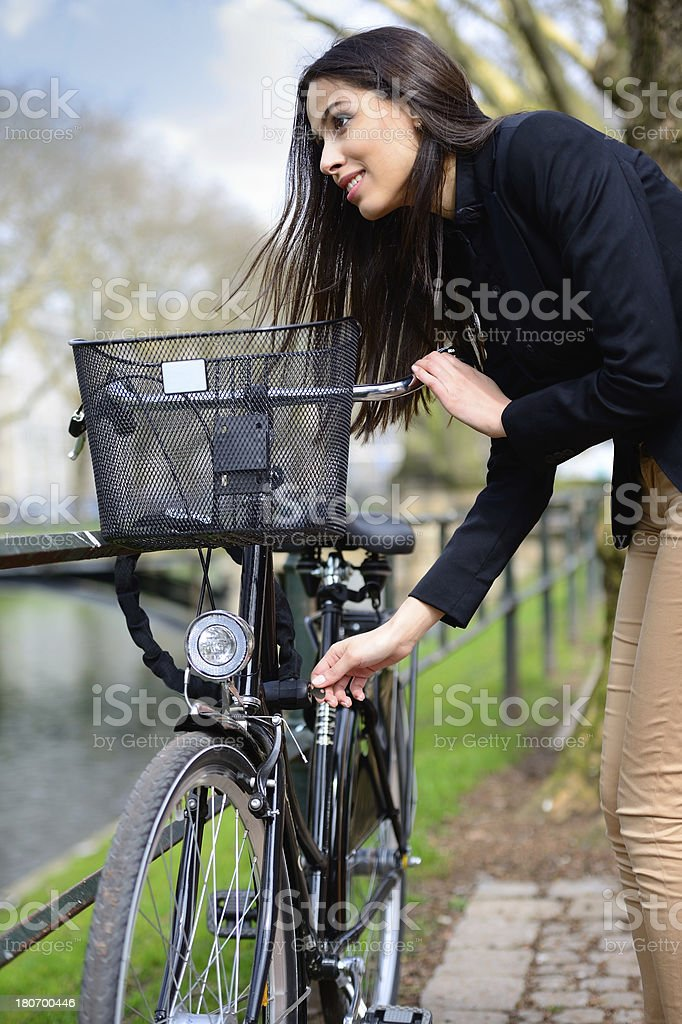 Springtime, girl and bicycle royalty-free stock photo
