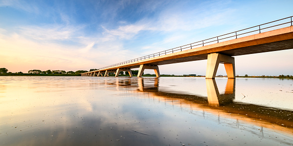 Springtime Sunset Over A Bridge Over A Lake During A Beautiful Evening In May Stock Photo - Download Image Now