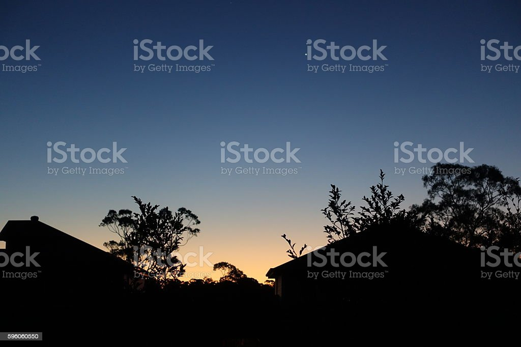 Springtime sunset silhouette of houses royalty-free stock photo