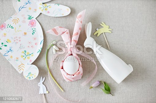 Pastel color easter table decoration with a sweet Easter bunny
