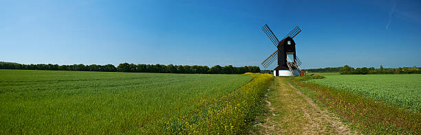 Springtime Windmill Panorama Springtime sunshine falls on a windmill in the English countryside. Panoramic made up of multiple images. buckinghamshire stock pictures, royalty-free photos & images
