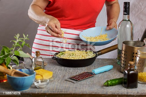 istock Sprinkle cheese, cheese, pasta bake, mac, hand sprinkling parmesan, parmesan cheese, shrimp, grating cheese 1168874379