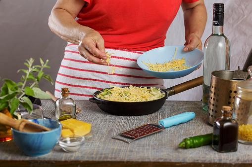 istock Sprinkle cheese, cheese, pasta bake, mac, hand sprinkling parmesan, parmesan cheese, shrimp, grating cheese 1168874379