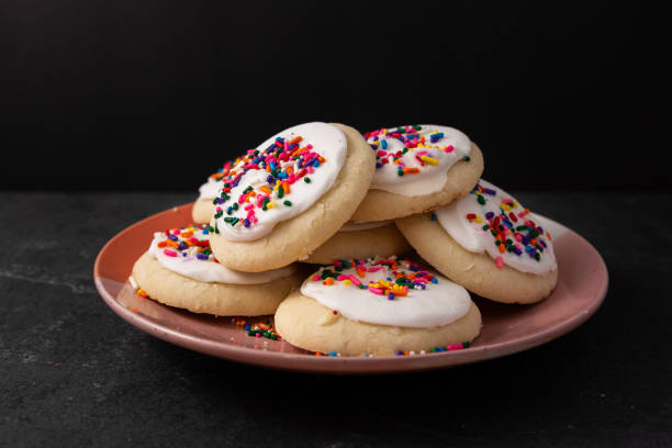 Sprinkle cookies with vanilla icing Sprinkle cookies with vanilla icing sugar cookie stock pictures, royalty-free photos & images