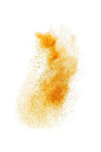 Turmeric or curry powder flying , studio shot, selective focus.