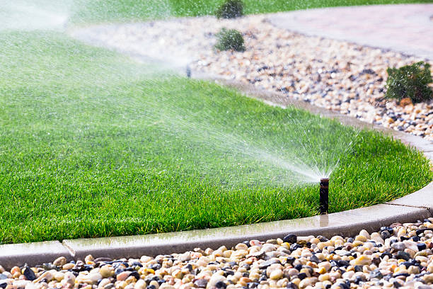 Sprinklers Automatic sprinklers watering lawn lawn stock pictures, royalty-free photos & images