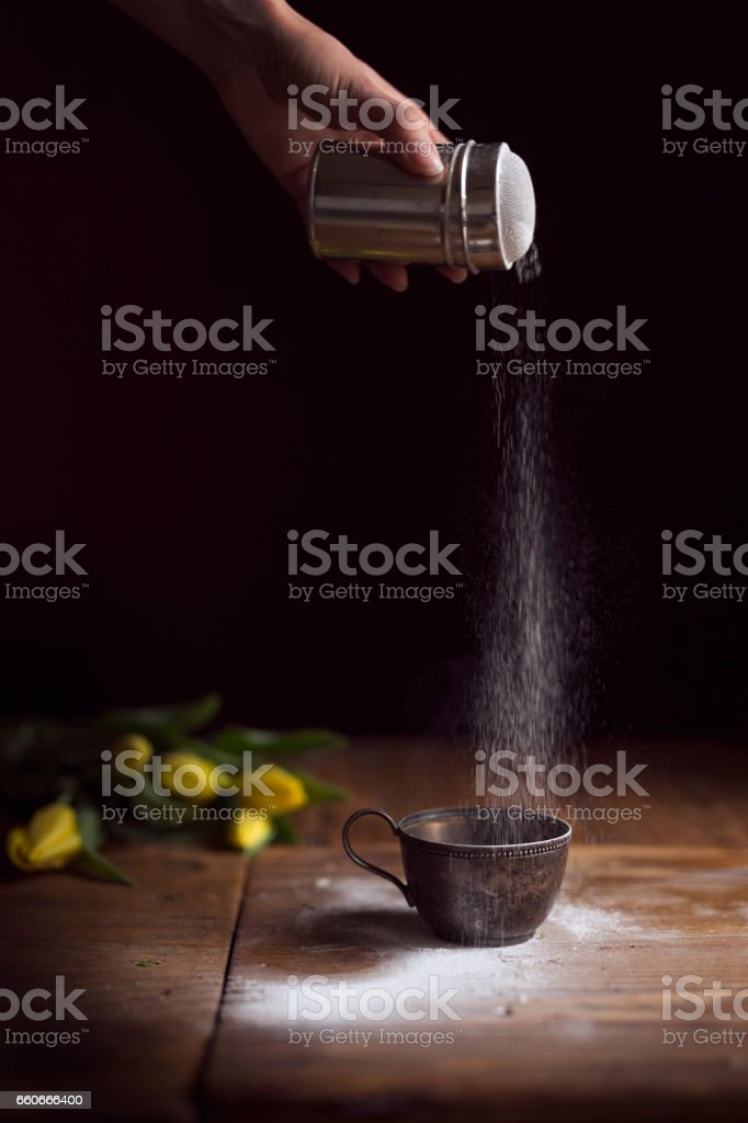 Sprinkling powdered sugar stock photo