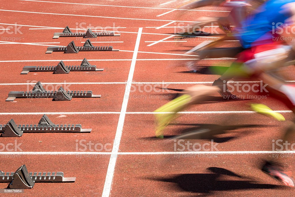 sprint start in blurred motion sprint start in track and field in blurred motion Activity Stock Photo