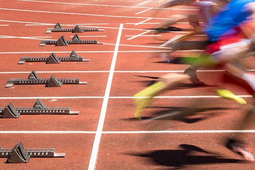 Sprint Start In Blurred Motion Stock Photo - Download Image Now