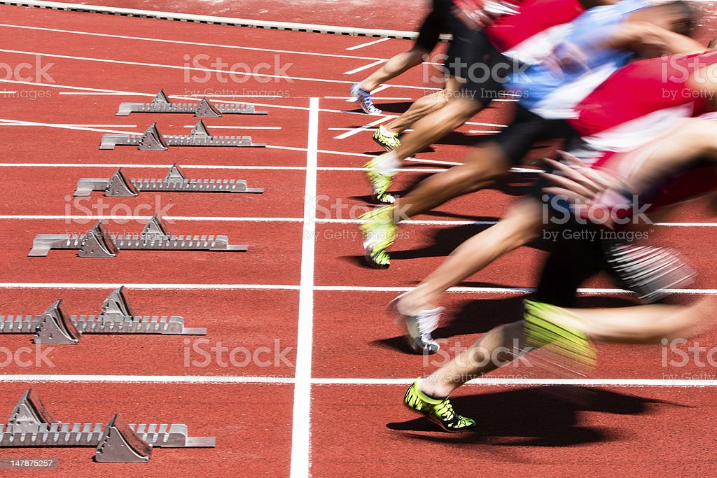sprint start in track and field athletes in sprint start in track and field Activity Stock Photo