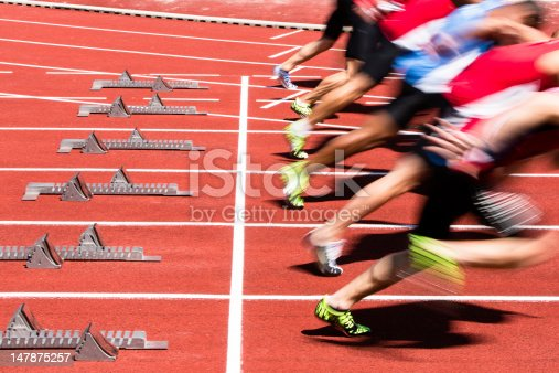 athletes in sprint start in track and field