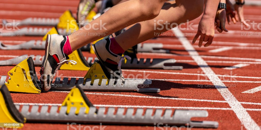 sprint start in track and field feet of some sprinter in sprint start in track and field Activity Stock Photo