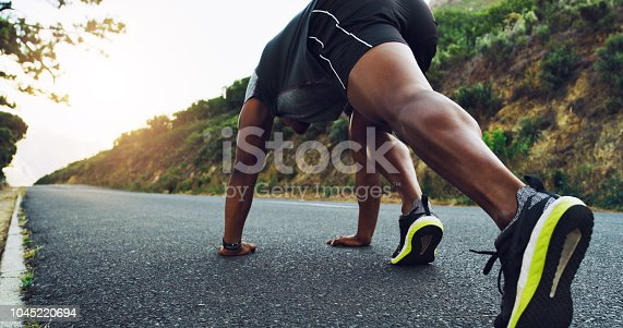 Rearview shot of a sporty young man exercising outdoors