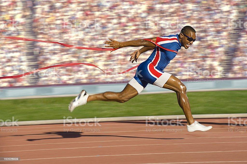 Sprinter de franchir la ligne d'arrivée - Photo