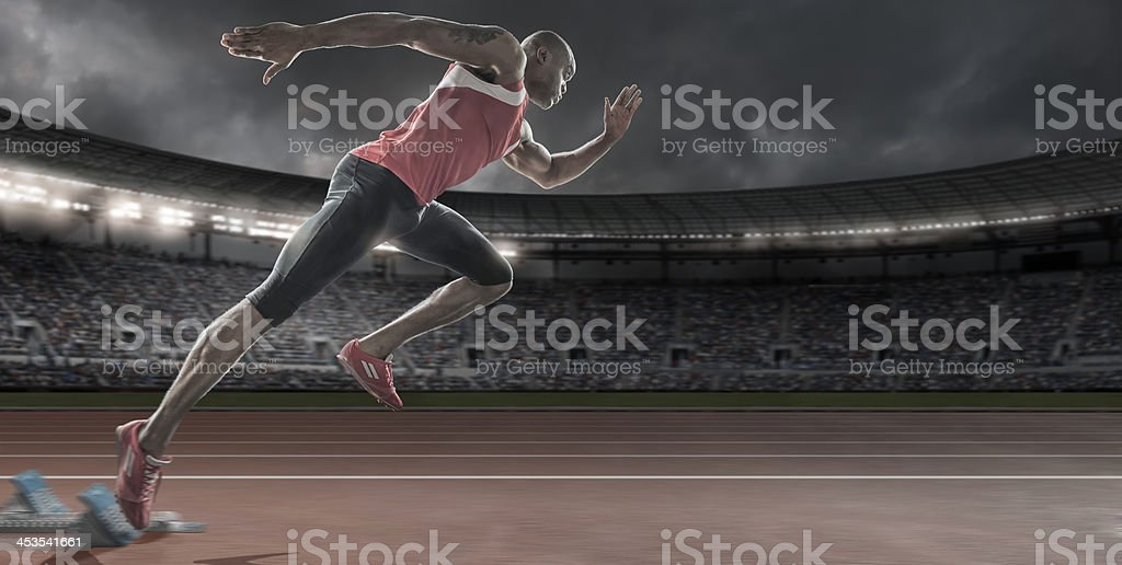 Sprinter in Mid Flow Bursting Out Of Starting Blocks stock photo