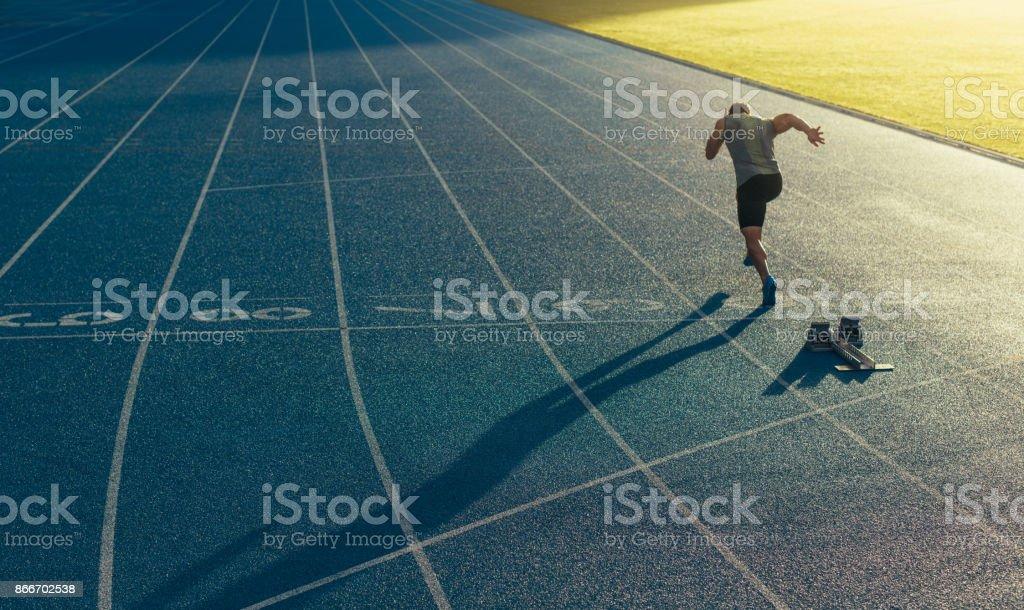 Sprinter running on track stock photo