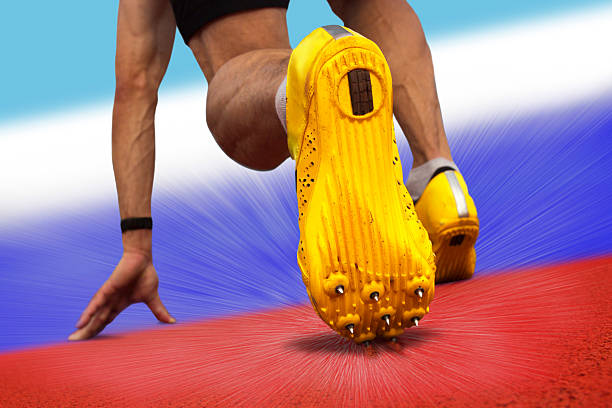 Sprinter start position Sprinter starts on surface with russian national colors studded stock pictures, royalty-free photos & images