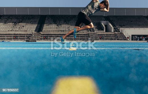 istock Sprinter taking off for a run from the start line 907856532