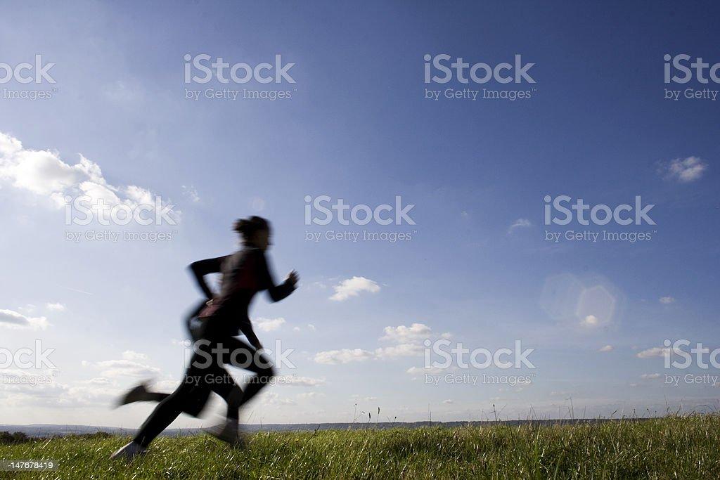 Sprinting across field stock photo