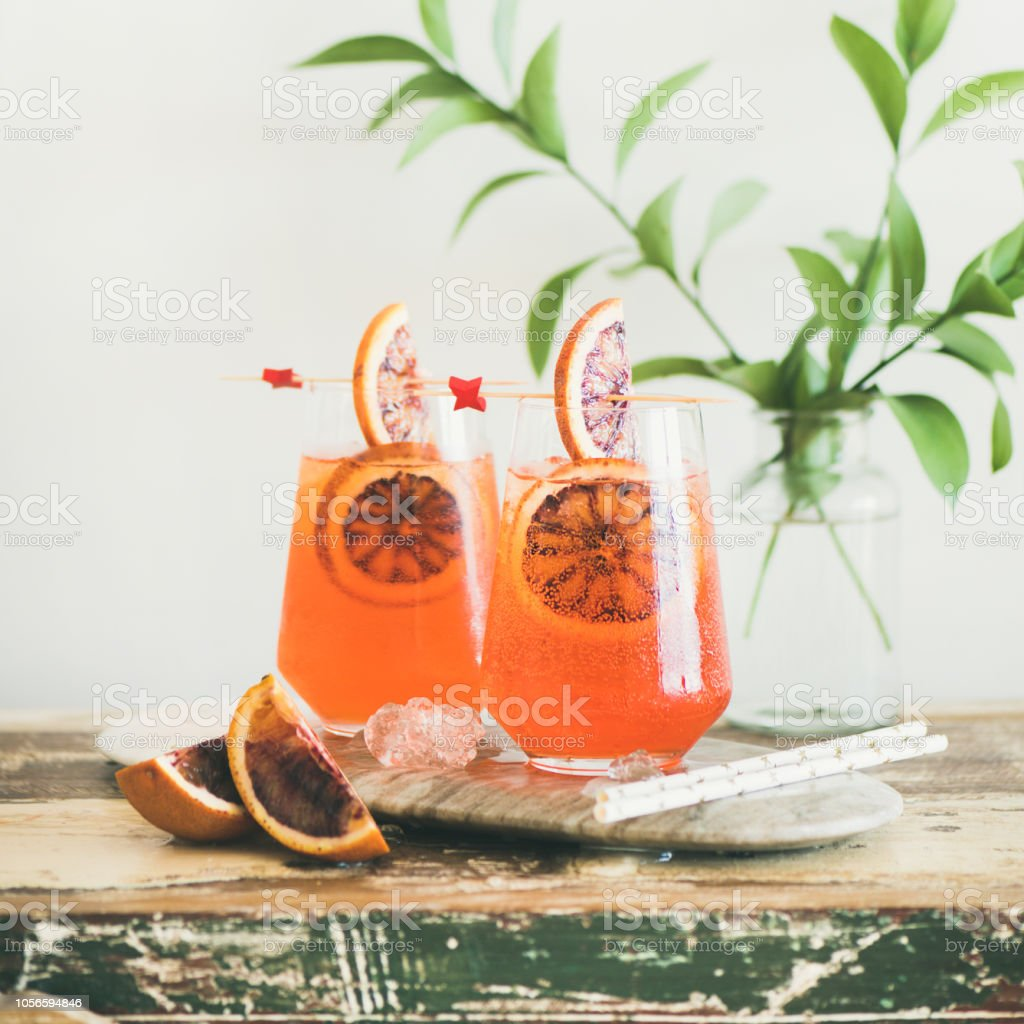 Aperol Spritz alcohol cocktail with orange and ice, square crop stock photo