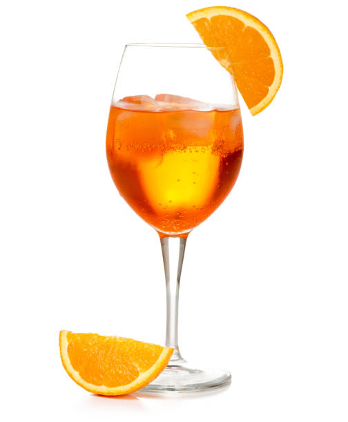 spritz aperitif isolated on white spritz cocktail in a wineglass garnished with orange slice isolated on white spraying stock pictures, royalty-free photos & images