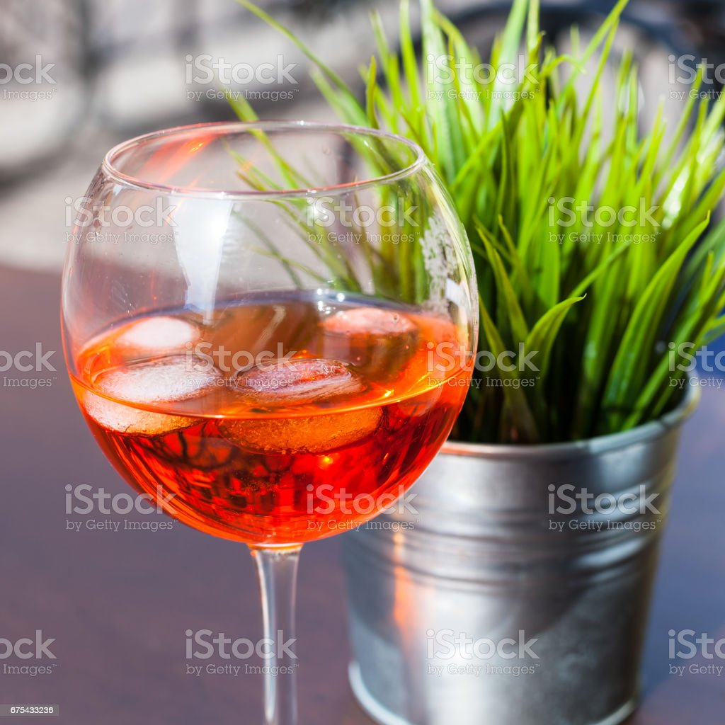 Spritz cocktail drink with ice on table royalty-free stock photo